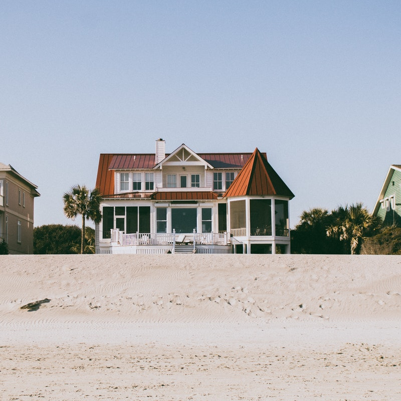 A beautiful house on a beach.